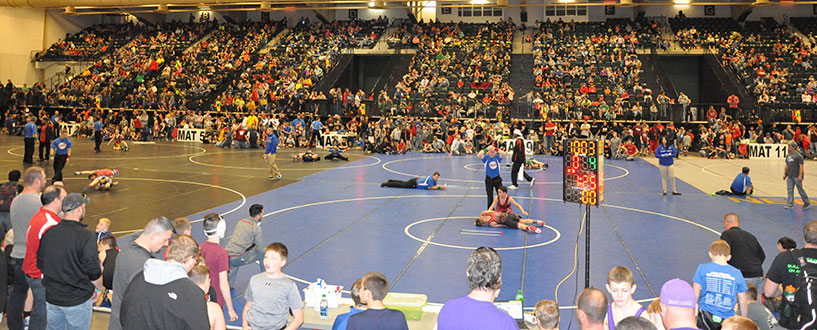 View of several wrestling mats from the stands